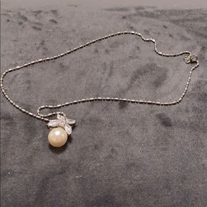 Pearl and silver necklace.